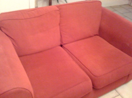 The cushions of this sofa are about half a square metre each